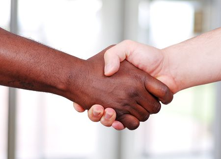 Shaking hands, black and white in the office photo
