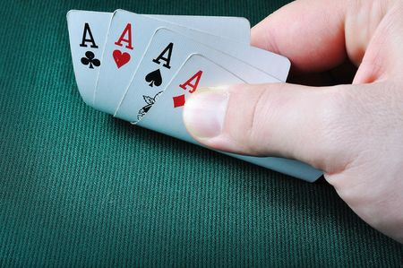 Four aces in casino on green background photo