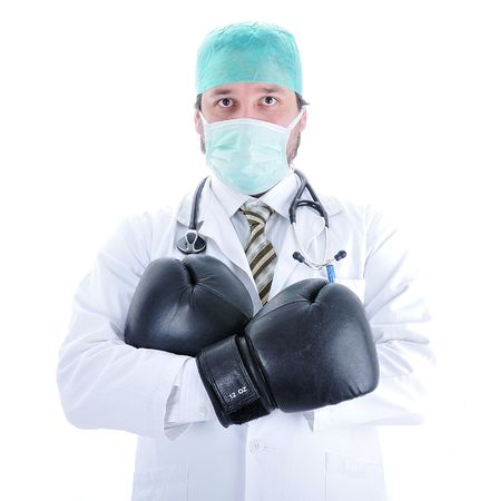 medical fight: Young doctor with boxing gloves Stock Photo
