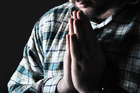 Man praying in the dark photo