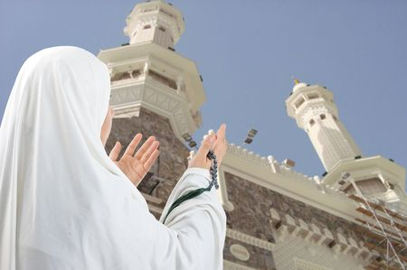 girl alone:  Young woman, muslim pilgrim in white traditional clothes