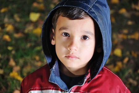 Little cute sad kid outdoor photo