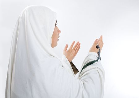 islamic prayer: Young woman, muslim pilgrim in white traditional clothes