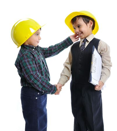 Little cute engineers isolated, kids playing together Stock Photo - 6013398