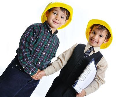 Little cute engineers isolated, kids playing together photo