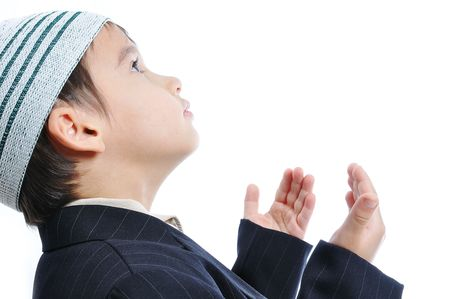 Muslim little cute kid with hat, isolated photo