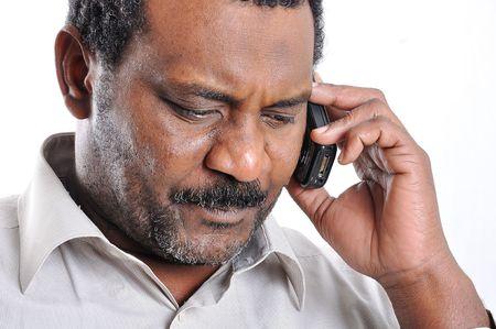 African American man speaking on phone photo