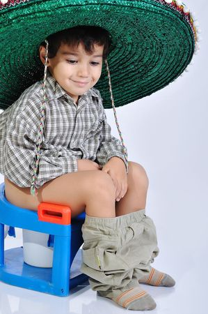 pissing: Cute kid with mexican hat on head Stock Photo