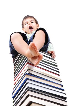 legs wide open: Book tower made of many books and person Stock Photo