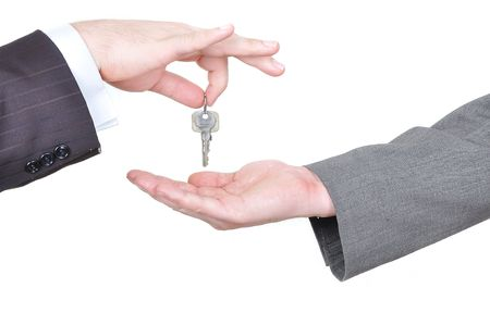 possession: Two businessmen hands and the key