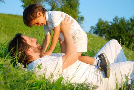 Scene of family happiness on beautiful green meadow photo