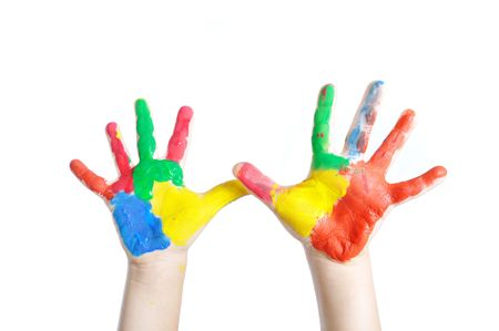 fingerpaint:  Child hands painted in colorful paints ready for hand prints