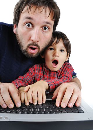 Father and son on laptop, shock  photo