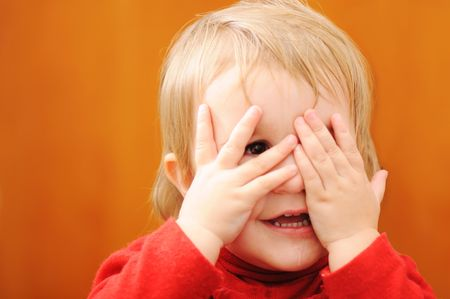 covering eyes: Baby hiding Stock Photo