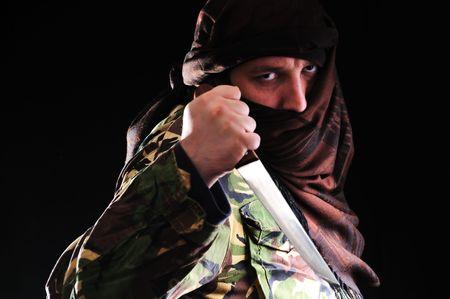 extremist: terrorist