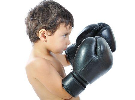 anger kid: Boxing gloves on children hands Stock Photo