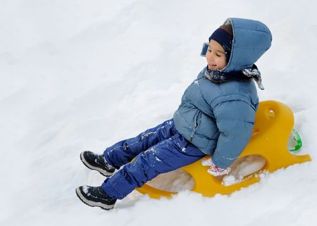 Great activity on snow, children and happiness photo