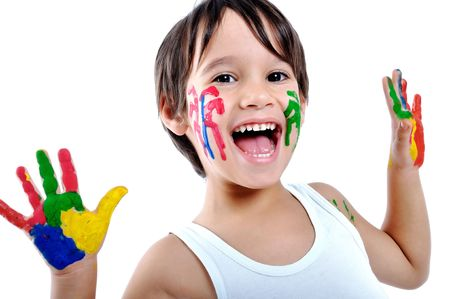 Five year old boy with hands painted in colorful paints ready for hand prints  photo
