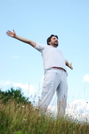 Man with his arms wide open  Stock Photo - 6325824
