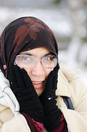 young beautiful muslim woman outdoor in winter Stock Photo - 6325785