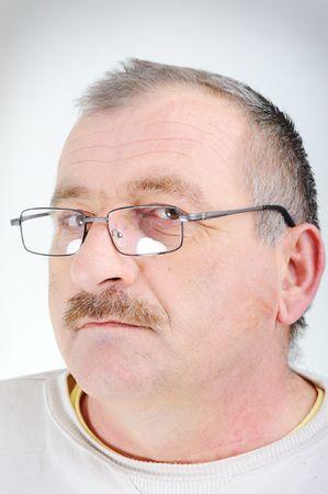 Elderly man with glasses, portrait Stock Photo - 6433550