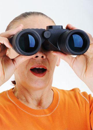 Elderly woman with binoculars photo
