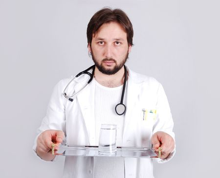 Young male doctor in white standing photo