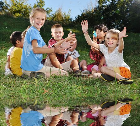 Happy group of children on lake photo