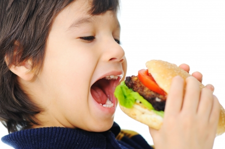 ni�os comiendo:   Burger, comida r�pida    Foto de archivo