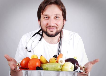 Young male doctor advising healthy natural food  photo