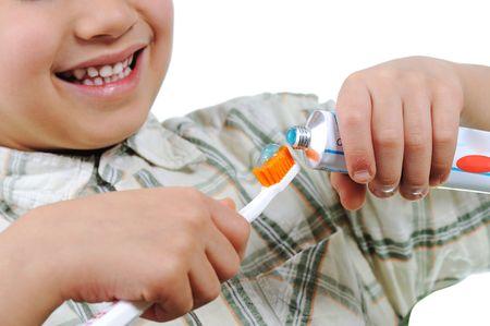 Little kid preparing for teeth brushing photo