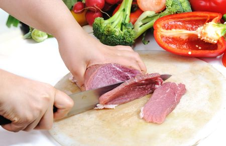 Preparing meal, meat and vegetables photo