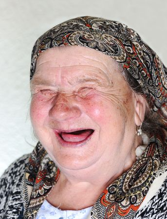 Elderly person, portrait in natural pose laughing Stock Photo