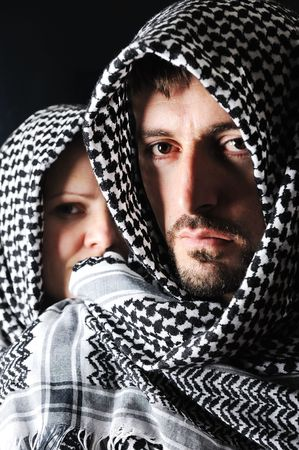 Man and woman with arabic palestinian colors photo