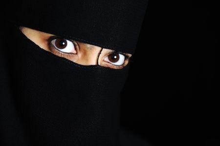 religious clothing: Mystery, woman, eyes, oriental, exotic Stock Photo