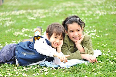 Cute children on meadow photo