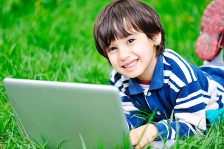Children activity with laptop in nature photo