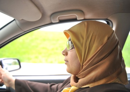 an a muslim woman in car, driver photo