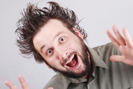 crazy young businessman facial expression photo