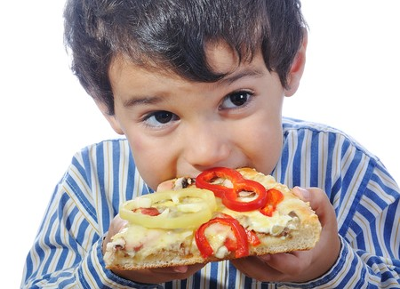 Cute little boy eating pizza, isolated Stock Photo - 7015485