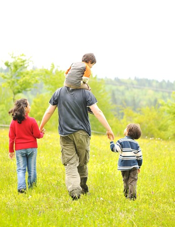 happy family in nature, father and children walking Stock Photo - 7992909