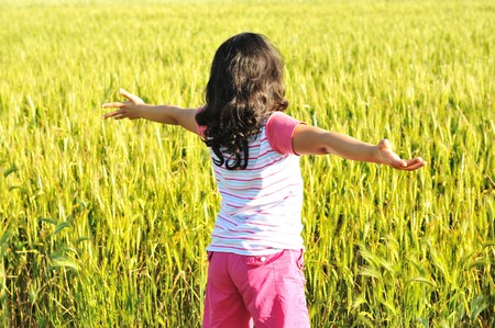 freedom girl: Freedom, girl in nature with opened arms Stock Photo