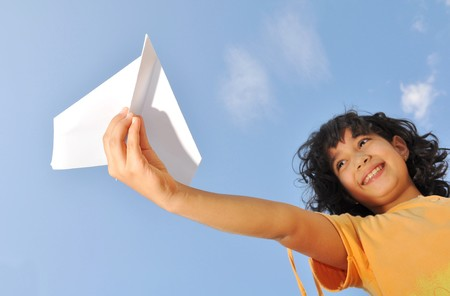 Little cute girl holding an airplane Stock Photo - 7992867