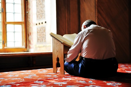 Prayer in mosque, reading Koran photo