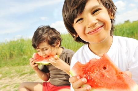 watermelon: Eating watermelon outside