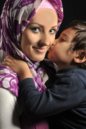 Muslim young woman with little cute kid Stock Photo - 7992956