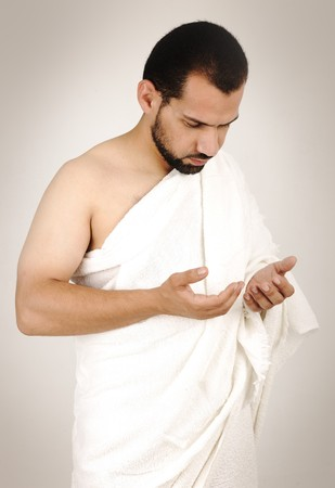 muslim pilgrim in white traditional clothes Stock Photo - 8084442