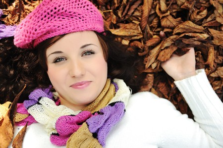 Close-up portrait of an beautiful autumn woman laying on ground Stock Photo - 8084464