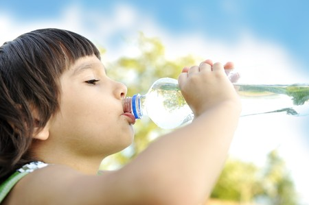 hot water: Child drinking pure water in nature Stock Photo