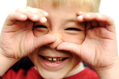 blonde boy: Happy blonde boy closeup, smiling, laughing, very happy with hands on his face